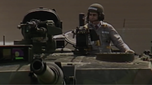 Still from a 1988 campaign ad for Republican presidential nominee George HW Bush mocking Democratic nominee Michael Dukakis for riding in an Abrams battle tank. Courtesy of Media Education Foundation.